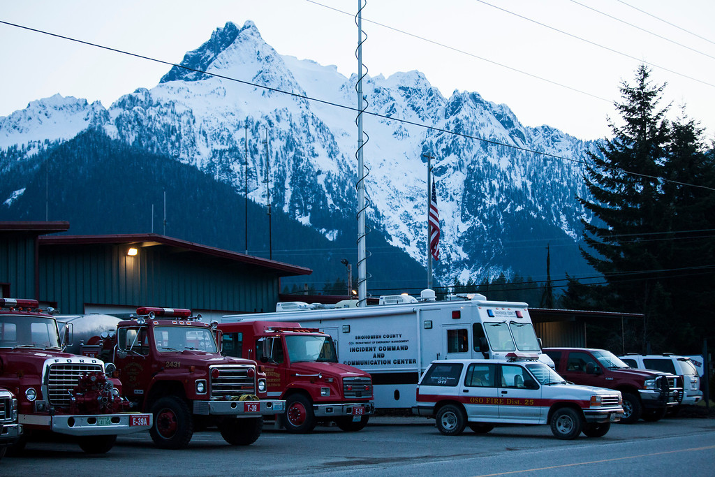 . Emergency response vehicles are pictured in Darrington, Washington on Sunday, March 23, 2014. (Photo by David Ryder/Getty Images)