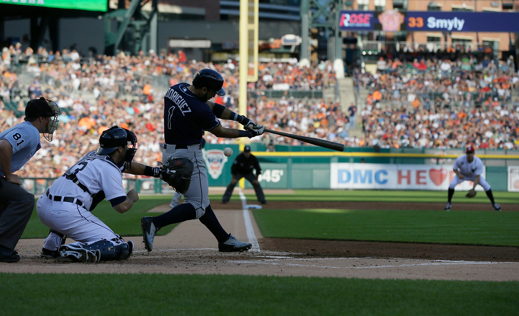 . Tampa Bay Rays\' Sean Rodriguez bats during the second inning of a baseball game against the Detroit Tigers in Detroit, Friday, July 4, 2014. (AP Photo/Carlos Osorio)