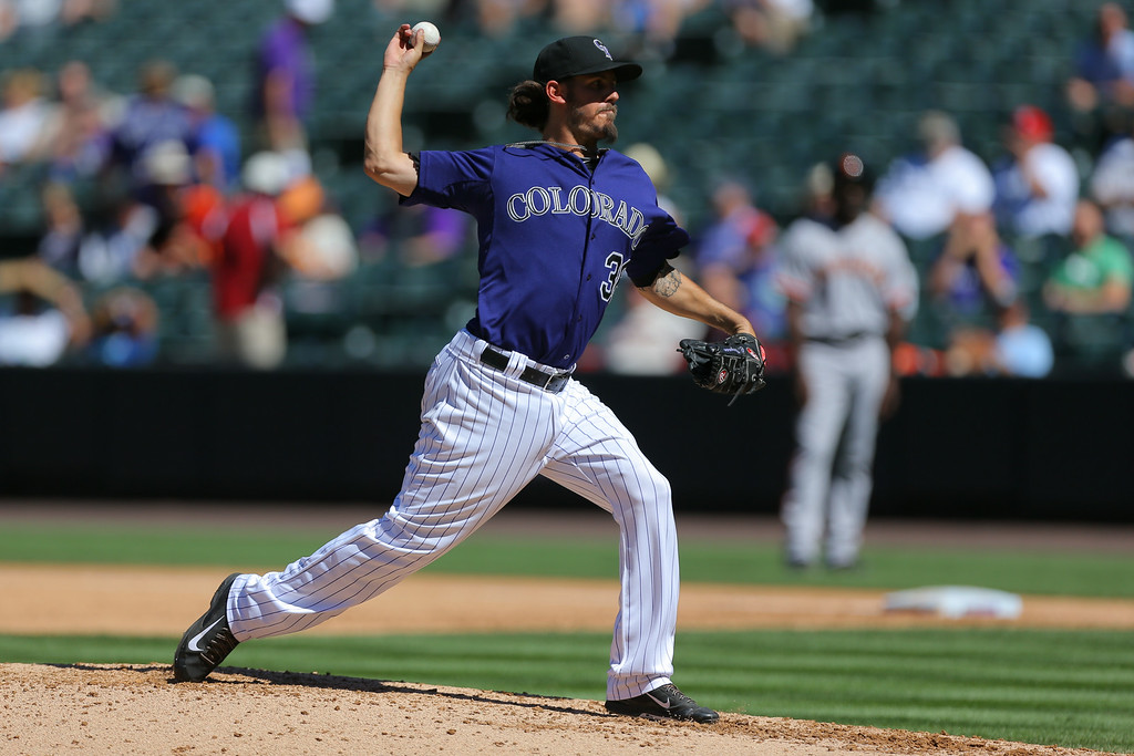 . DENVER, CO - SEPTEMBER 3:  Starting pitcher Christian Bergman #36 of the Colorado Rockies delivers to home plate during the fifth inning against the San Francisco Giants at Coors Field on September 3, 2014 in Denver, Colorado. (Photo by Justin Edmonds/Getty Images)
