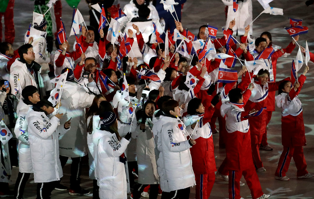 . North Korean, in red, and South Korean athletes march into the stadium during the closing ceremony of the 2018 Winter Olympics in Pyeongchang, South Korea, Sunday, Feb. 25, 2018. (AP Photo/Chris Carlson)