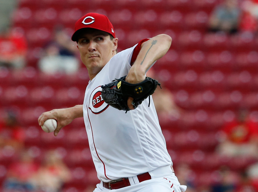 . Cincinnati Reds starting pitcher Homer Bailey throws against the Cleveland Indians during the first inning of a baseball game, Monday, Aug. 13, 2018, in Cincinnati. (AP Photo/Gary Landers)