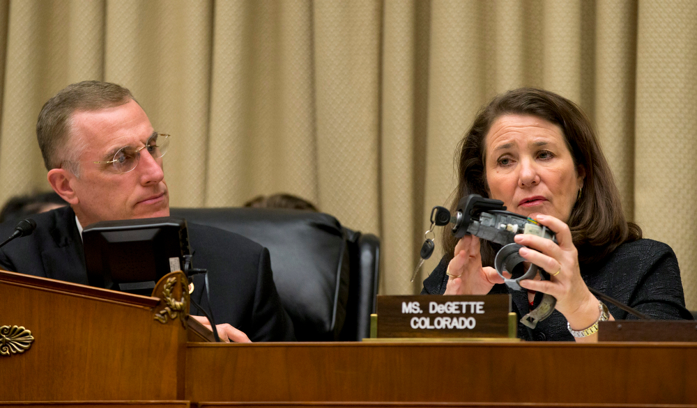 . House Oversight and Investigations subcommittee Chairman Rep. Tim Murphy, R-Pa., watches at left as the subcommittee\'s ranking member, Rep. Diana DeGette, D-Colo. holds up a GM ignition switch, on Capitol Hill in Washington, Tuesday, April 1, 2014, as General Motors CEO Mary Barra testified before the committee. The committee is looking for answers from Barra about safety defects and mishandled recall of 2.6 million small cars with a faulty ignition switch that\'s been linked to 13 deaths and dozen of crashes. (AP Photo/J. Scott Applewhite)
