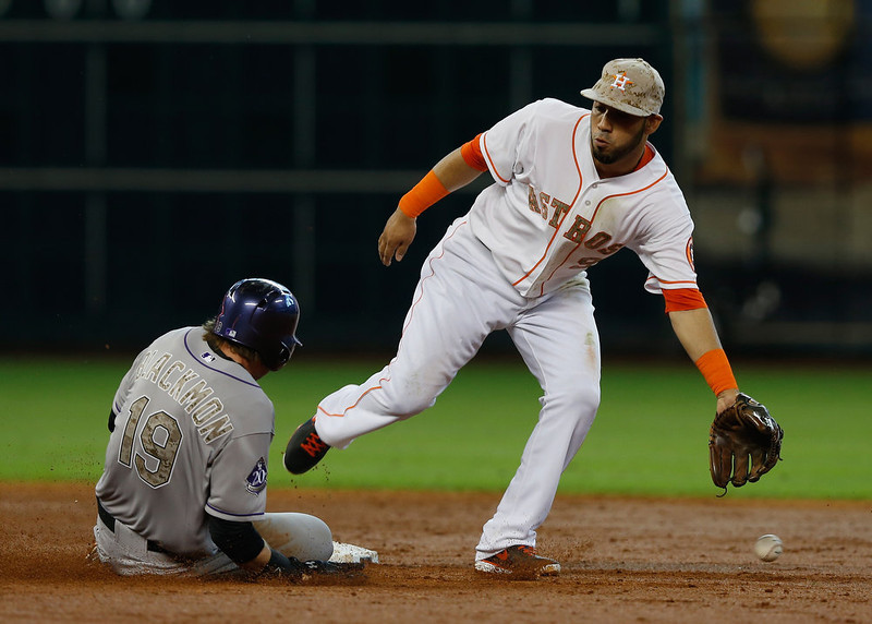 . Charlie Blackmon #19  of the Colorado Rockies steals second base in the second inning as Marwin Gonzalez #9 of the Houston Astros cannot make the play at Minute Maid Park on May 27, 2013 in Houston, Texas. (Photo by Scott Halleran/Getty Images)
