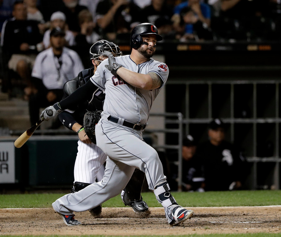 . Cleveland Indians\' Yonder Alonso watches his RBI double off Chicago White Sox relief pitcher Jace Fry during the eighth inning of a baseball game Wednesday, June 13, 2018, in Chicago. Michael Brantley scored. (AP Photo/Charles Rex Arbogast)