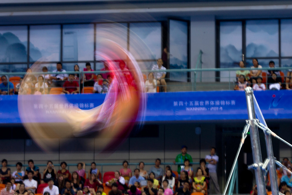 . Switzerland\'s Giulia Steingruber performs on the uneven bars during the women\'s qualifying round of the Artistic Gymnastics World Championships at the Guangxi Gymnasium in Nanning, capital of southwest China\'s Guangxi Zhuang Autonomous Region Sunday, Oct. 5, 2014. (AP Photo/Andy Wong)