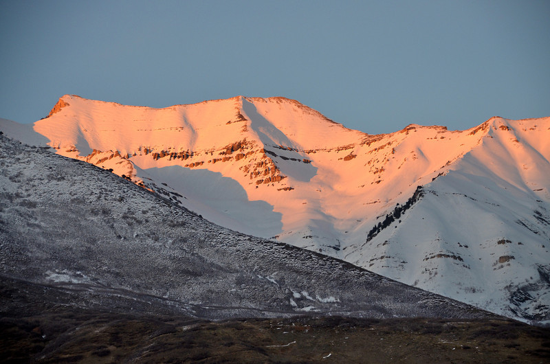 2012-3-17 ––– I was driving home in my convertible as the sun was setting and saw this image of the sun casting a warm glow across the peeks of Timpanogos and pulled over to take this picture. I love living close to the mountains.