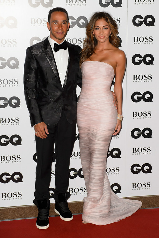 . British racing driver Lewis Hamilton, left, and U.S singer Nicole Scherzinger arrive for the GQ Men Of The Year Awards 2014 at a central London venue, London, Tuesday, Sept. 2, 2014. (Photo by Jonathan Short/Invision/AP)