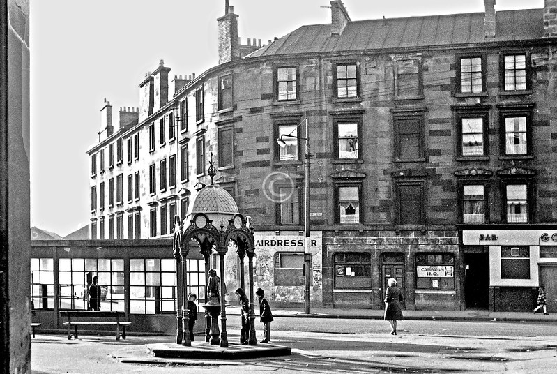 Govan Cross from Water Row.   The Aitken Memorial Fountain was erected in memory of a local GP.     February 1974