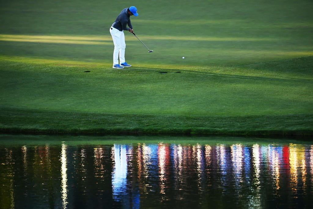 . Northern Ireland\'s Rory McIlroy plays a shot on the 16th green during Round 3 of the 80th Masters Golf Tournament at the Augusta National Golf Club on April 9, 2016, in Augusta, Georgia. / AFP PHOTO / Jim WatsonJIM WATSON/AFP/Getty Images