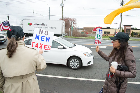 04/15/19 Wesley Bunnell | Staff Local TEA Party members protested taxes on Queen St. in Southington on April 15th which is the federal deadline for filing taxes. Protestors hold signs asking for no new taxes.