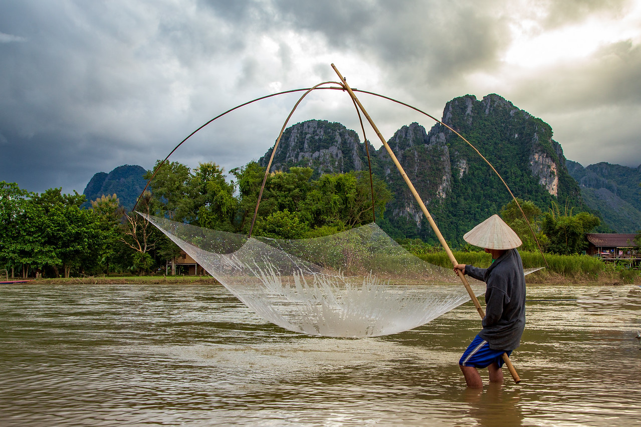 Traditional Net Pole Fisherman in Viang Veng, Laos
