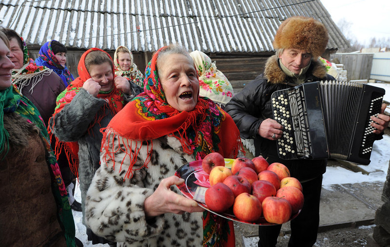 . A woman holds a plate of apples during Christmas celebration in the town of Richev, some 290 km south from Minsk. on January 7, 2013. Orthodox Christians celebrate Christmas on January 7 in the Middle East, Russia and other Orthodox churches that use the old Julian calendar instead of the 17th-century Gregorian calendar adopted by Catholics, Protestants, Greek Orthodox and commonly used  attendsin secular life around the world.   AFP PHOTO / VIKTOR  DRACHEV/AFP/Getty Images