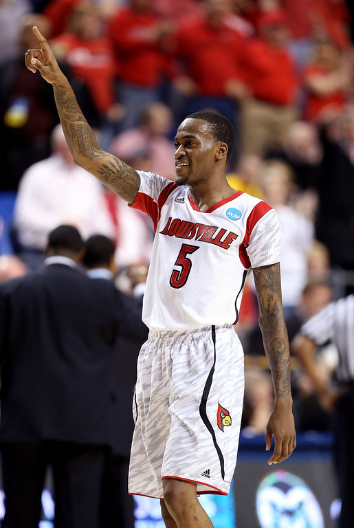 . LEXINGTON, KY - MARCH 23: Kevin Ware #5 of the Louisville Cardinals reacts after a play against the Colorado State Rams in the first half during the third round of the 2013 NCAA Men\'s Basketball Tournament at Rupp Arena on March 23, 2013 in Lexington, Kentucky.  (Photo by Andy Lyons/Getty Images)