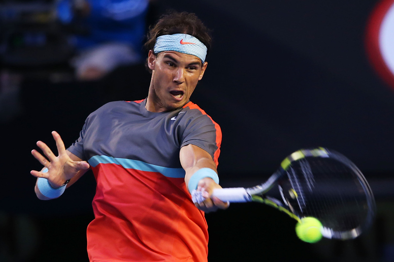 . Rafael Nadal of Spain plays a forehand in his semifinal match against Roger Federer of Switzerland during day 12 of the 2014 Australian Open at Melbourne Park on January 24, 2014 in Melbourne, Australia.  (Photo by Mark Kolbe/Getty Images)