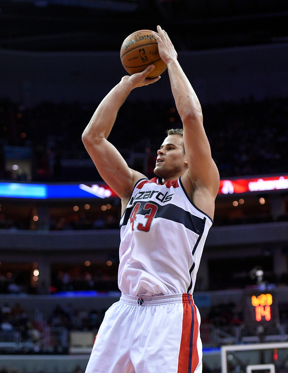 . Washington Wizards forward Kris Humphries (43) shoots during the second half of an NBA basketball game against the Denver Nuggets, Friday, Dec. 5, 2014, in Washington. (AP Photo/Nick Wass)