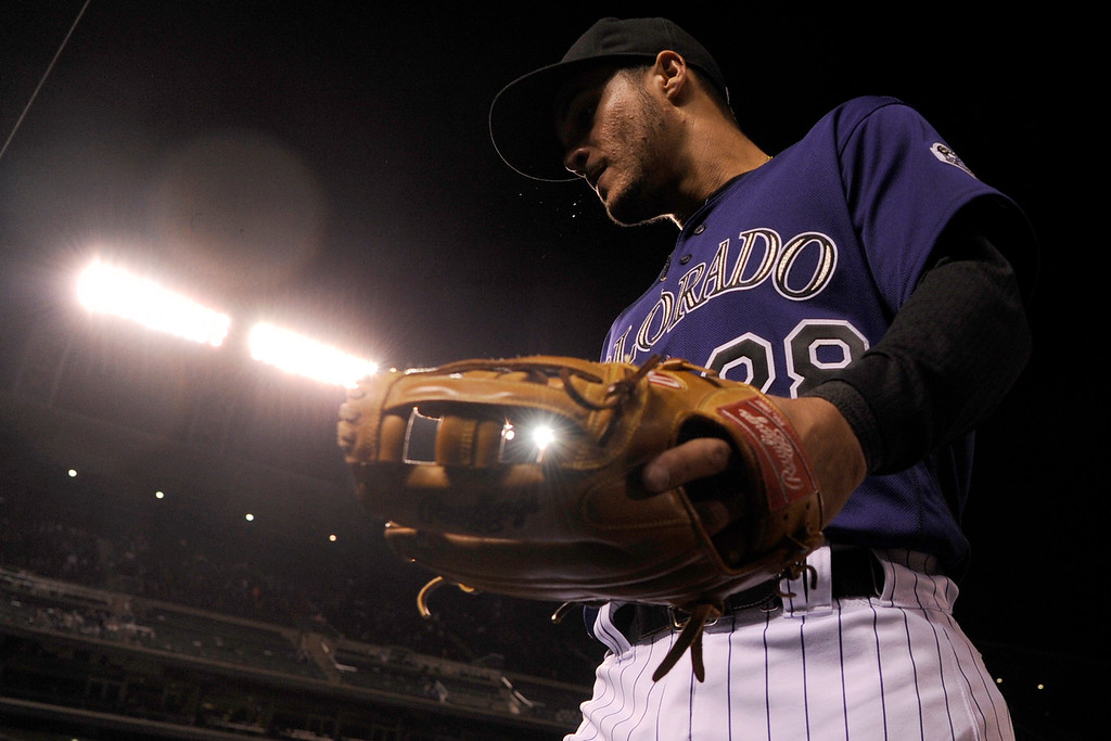 . DENVER, CO - APRIL 25: Nolan Arenado (28) of the Colorado Rockies walks into the dugout after the top half of the sixth inning at Coors Field. The Colorado Rockies hosted the Pittsburgh Pirates on Monday, April 25, 2016. (Photo by AAron Ontiveroz/The Denver Post)