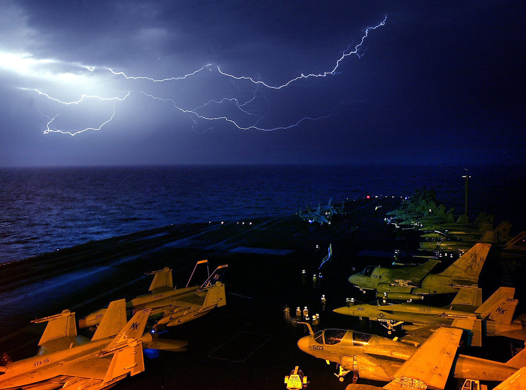 . A thunderstorm lights up the sky in the Persian Gulf as attack flights over Iraq continued throughout the night off of the USS Abraham Lincoln, Tuesday, March 25, 2003. (Vincent Laforet/The New York Times)