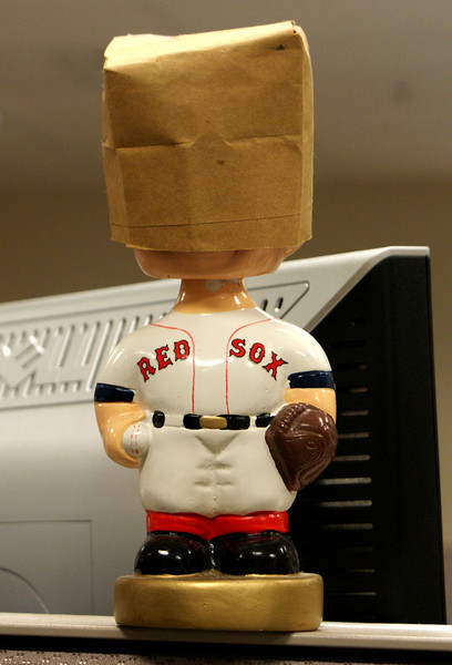 A Shameful performance: The Red Sox blew a 9-7 lead against the Yankees in the 9th and lost 11-9, so now (as I do with every Sox loss) I must put the paperbag on my Red Sox bobblehead.