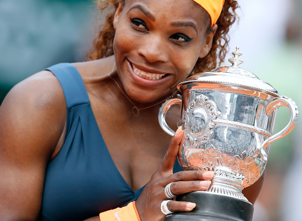 . USA\'s Serena Williams poses with the Suzanne-Lenglen trophy after winning the 2013 French tennis Open final against Russia\'s Maria Sharapova at the Roland Garros stadium in Paris on June 8, 2013. AFP PHOTO / PATRICK  KOVARIK/AFP/Getty Images