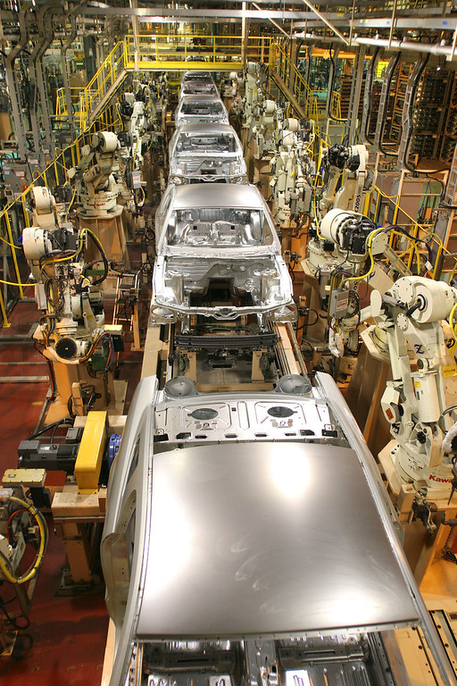 . New 2005 Ford Mustangs are assembled at a new plant known as Auto Alliance International September 27, 2004 in Flat Rock, Michigan. Ford Motor Company invested approximately $700 million in the new plant\'s flexible manufacturing system, which includes a new body shop with 380 robots. The new system enables the plant to build six new models on two vehicle platforms.  (Photo by Bill Pugliano/Getty Images)