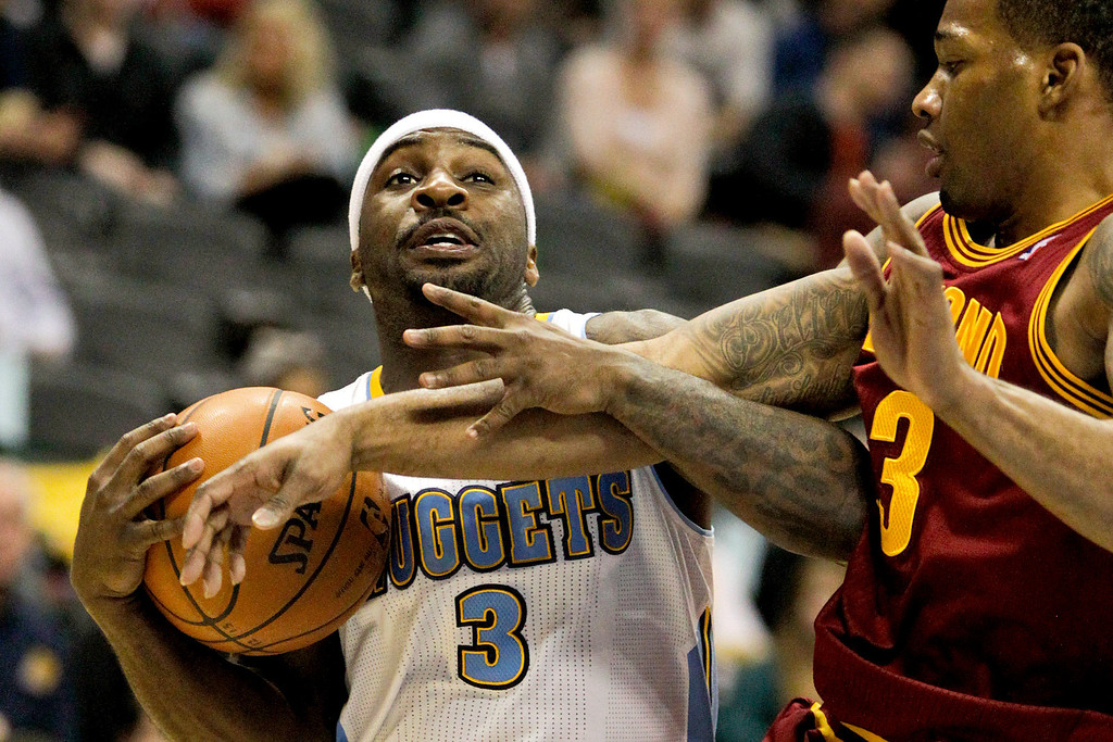 . Denver Nuggets\' Ty Lawson (3) is fouled by Cleveland Cavaliers\' Dion Waiters (3) during the first quarter of an NBA basketball game Friday, Jan. 11, 2013, in Denver. (AP Photo/Barry Gutierrez)