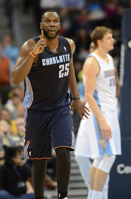 . Al Jefferson of the Charlotte Bobcats (25) celebrates the scoring during the second half of the game against the Denver Nuggets at Pepsi Center. (Photo by Hyoung Chang/The Denver Post)