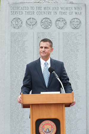 09/11/18 Wesley Bunnell | Staff New Britain unveiled its newest monument in Central Park which is dedicated to the War on Terror following the 9/11 attacks. General Manager of the New Britain Memorial-Sagarino Funeral Home Jonathan Raymond speaks.