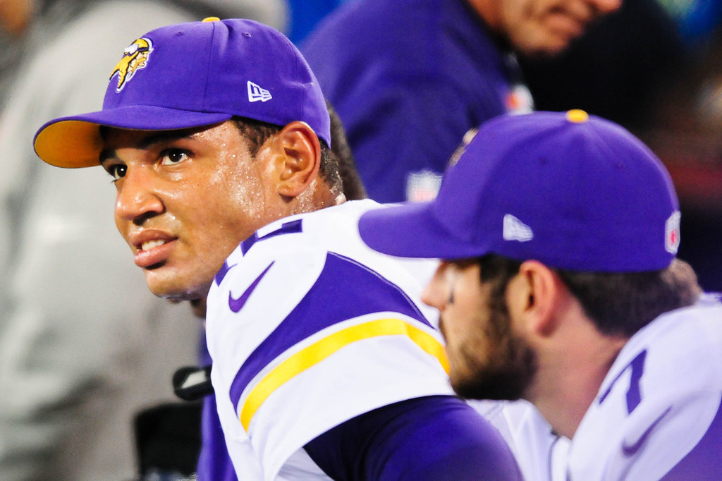 . Vikings quarterback Josh Freeman, left, rests alongside the player he replaced, Christian Ponder, in the fourth quarter against the Giants. (Pioneer Press: Ben Garvin)