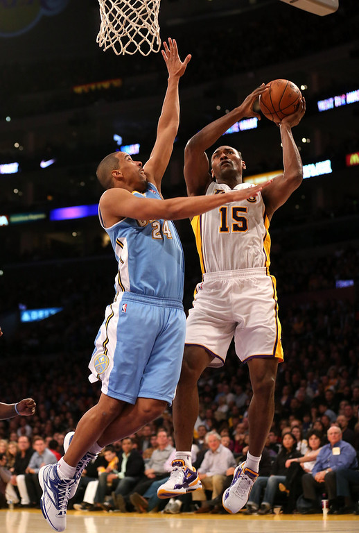 . Metta World Peace #15 of the Los Angeles Lakers shoots over Andre Miller #24 of the Denver Nuggets at Staples Center on January 6, 2013 in Los Angeles, California.   (Photo by Stephen Dunn/Getty Images)