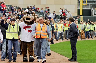 TC Bear mascot and Target Field construction workers lead celebration parade