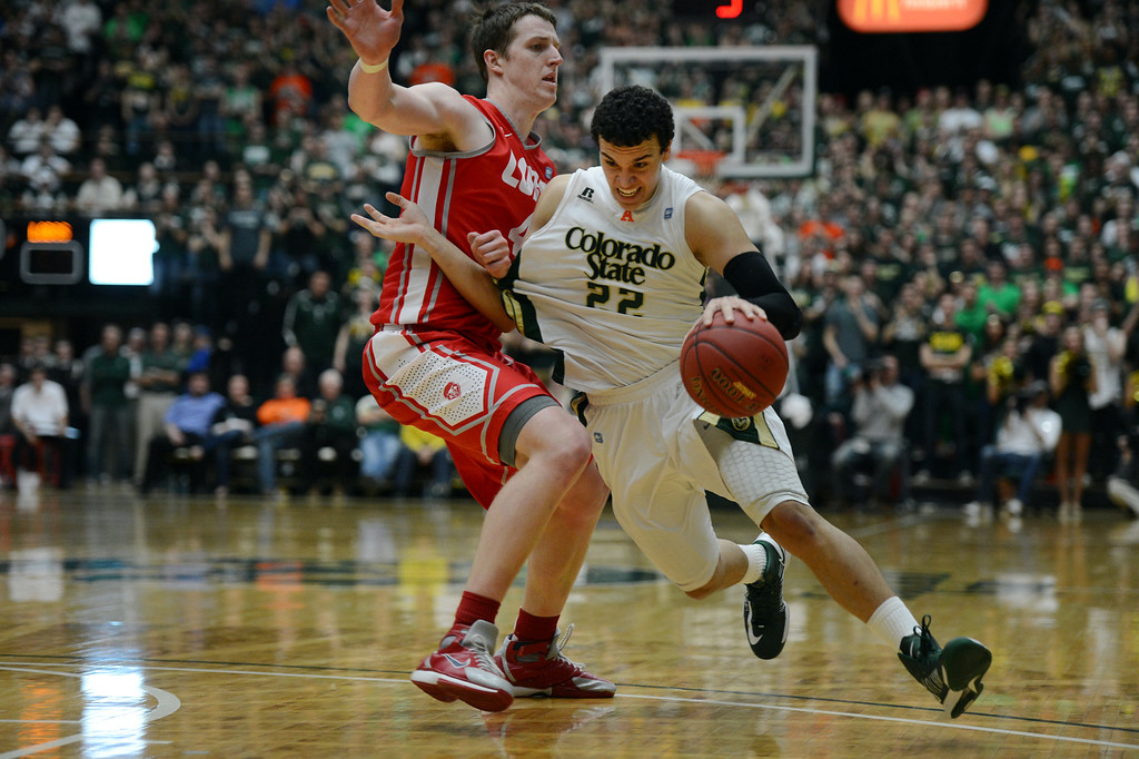 . Fort COLLINS, CO. - FEBRUARY 23: CSU Dorian Green drives past New Mexico Cameron Bairstow during second half action at Moby Arena in Fort Collin, CO February  24, 2013. The Colorado State Rams mens basketball team lost to the New Mexico Lobos, 82-91. (Photo By Craig F. Walker/The Denver Post)