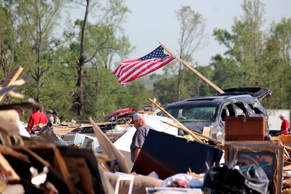 . In this handout provided by the Arkansas National Guard, people walk amongst the rubble following a deadly tornado April 28, 2014 in Vilonia, Arkansas.  (Photo by Arkansas National Guard via Getty Images)