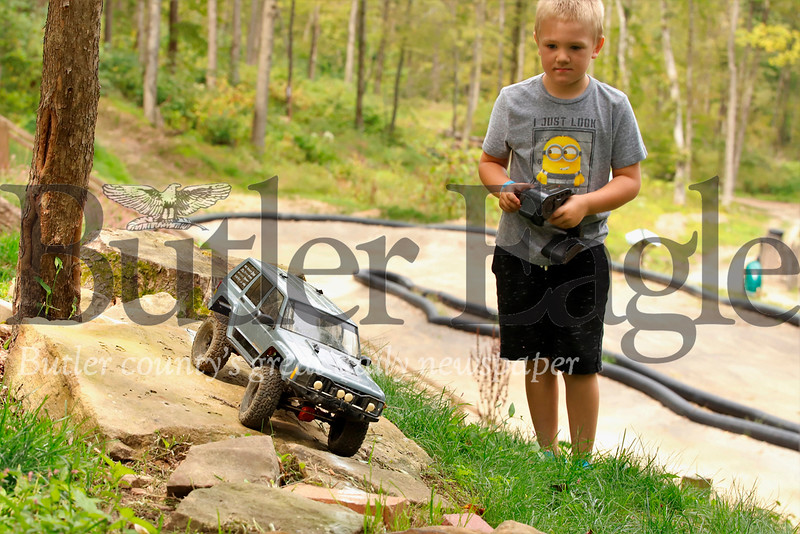 Garrett Richter, 7, of Sarver steers his remote control Jeep on the RC course at Yogie Bear's Jellystone Park at Kozy Rest in Harrisville. Seb Foltz/Butler Eagle