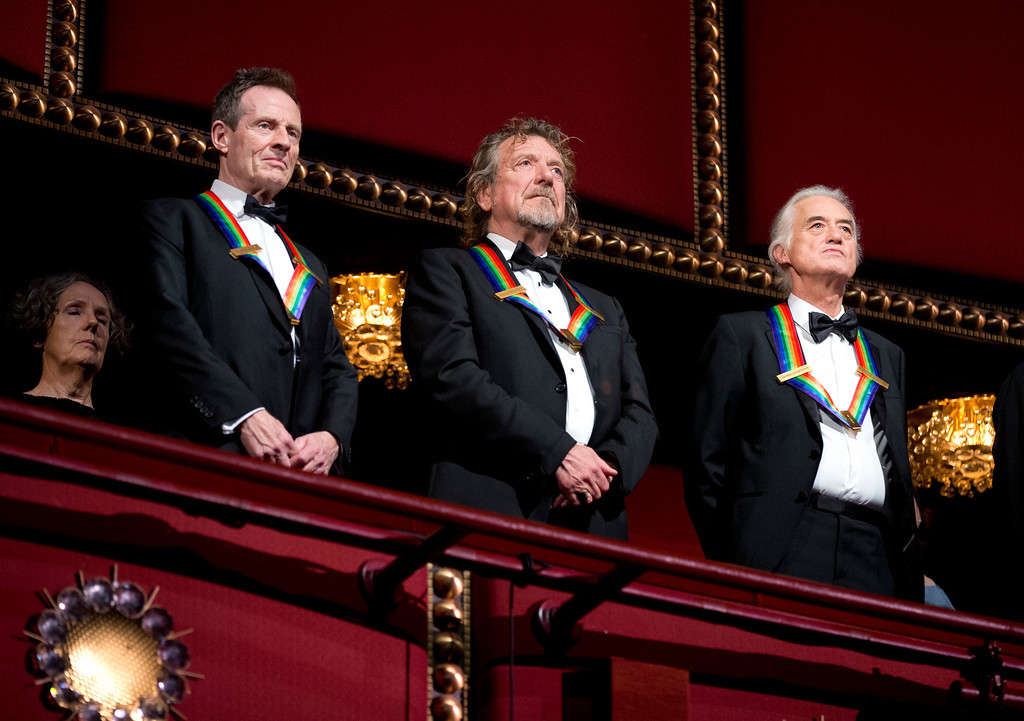 . Rock band Led Zeppelin, from left, keyboardist/bassist John Paul Jones, singer Robert Plant, guitarist Jimmy Page, stand as the Star Spangled Banner is played during the Kennedy Center Honors Gala at the Kennedy Center in Washington, Sunday, Dec. 2, 2012. While Led Zeppelin is being honored as a band, surviving members Jones, Page, and Plant, each received the Kennedy Center Honors. (AP Photo/Manuel Balce Ceneta)