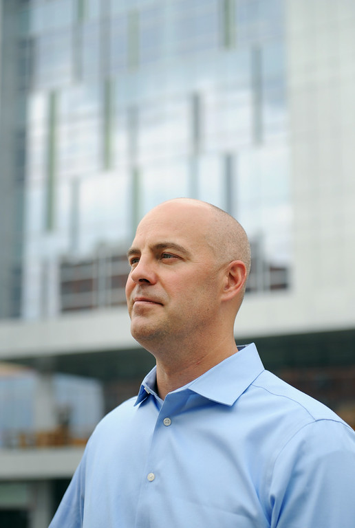 . Bill Gregor, Director of Operations for Mortenson Construction, stands in front of Exempla Saint Joseph Hospital, which has been under construction since July, 2011, and will receive its first patient in the new facility mid-December of this year. Photo by Jamie Cotten, Special to The Denver Post