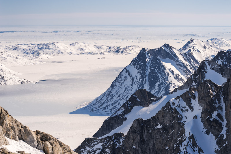 View over mountains and sea ice, East Greenland