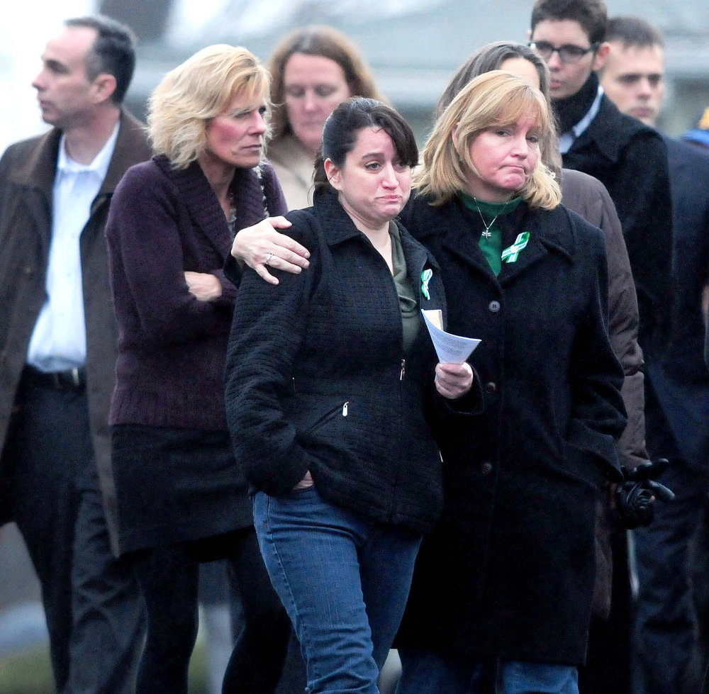 Description of . Mourners leave the Honan Funeral Home in Newtown on 12/17/2012 after funeral services for six-year-old Jack Pinto, a victim of the Sandy Hook Elementary School shootings. Photo by Arnold Gold/New Haven Register