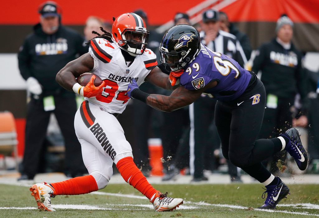 . Baltimore Ravens outside linebacker Matt Judon (99) tackles Cleveland Browns running back Isaiah Crowell (34) during the first half of an NFL football game, Sunday, Dec. 17, 2017, in Cleveland. (AP Photo/Ron Schwane)
