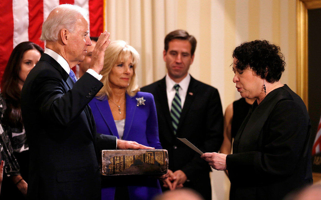 . U.S. Vice President Joe Biden (L) takes the oath of office from Supreme Court Justice Sonia Sotomayor as his wife Jill Biden holds the family bible while family members look on at the U.S. Naval Observatory in Washington January 20, 2013.     REUTERS/Kevin Lamarque