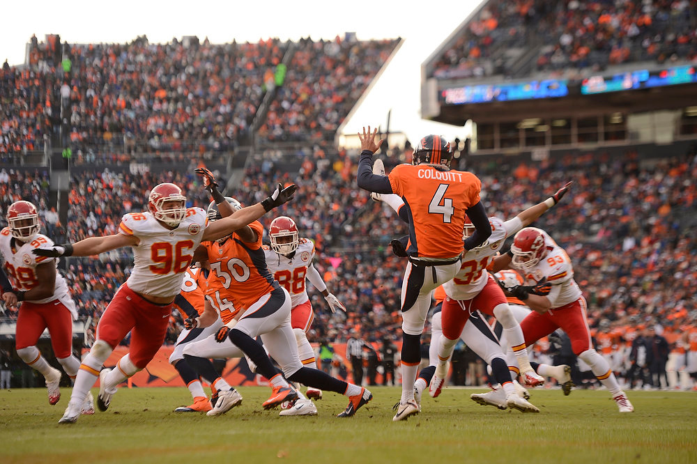 Description of . Denver Broncos punter Britton Colquitt (4) punts the ball as the Denver Broncos took on the Kansas City Chiefs at Sports Authority Field at Mile High in Denver, Colorado on December 30, 2012. John Leyba, The Denver Post