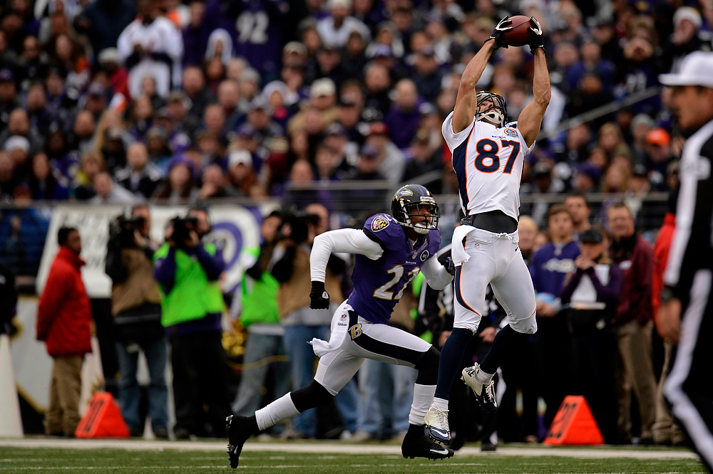 Description of . Denver Broncos wide receiver Eric Decker #87 makes a big first down catch at the end of the first quarter against the Baltimore Ravens at the M&T Bank Stadium, in Baltimore, MD Sunday December 16, 2012.      Joe Amon, The Denver Post