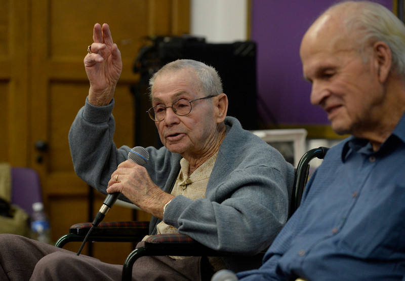 . WWII veteran, Harold Haberman, left, U.S. Marine Corp., speaks during a living history lesson for South High School students Wednesday morning, February 12, 2014. WWII U.S. Navy veteran, Carl Hammergren, right, listens and waits his turn to answer questions. (Photo By Andy Cross / The Denver Post)
