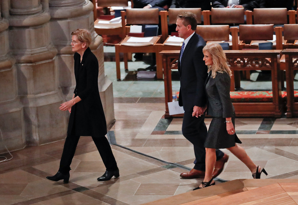 . From l-r., Sen. Elizabeth Warren, D-Mass., Sen. Jeff Flake, R-Ariz., and his wife Cheryl Flake, arrive with other dignitaries and invited guests to attend a memorial service for Sen. John McCain, R-Ariz., at Washington National Cathedral in Washington, Saturday, Sept. 1, 2018. McCain died Aug. 25, from brain cancer at age 81. (AP Photo/Pablo Martinez Monsivais)