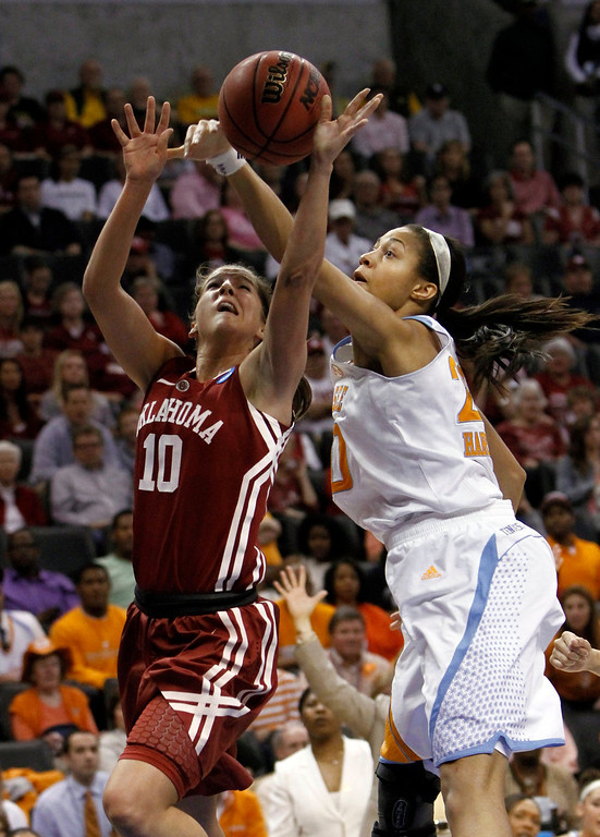 . Oklahoma\'s Morgan Hook (10) drives to the basket as Tennessee\'s Isabelle Harrison (20) defends during a regional semifinal game in the women\'s NCAA college basketball tournament in Oklahoma City, Sunday, March 31, 2013.  (AP Photo/Alonzo Adams)