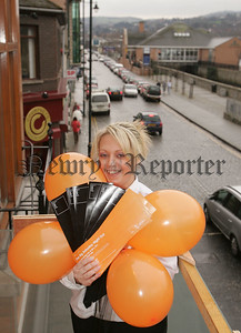 Moira Fegan of Bed Nightclub prepares baloons to announce the official opening of Bed, Newry's hottest new club on Saturday February 17th. Invites will be circulated by airmail as Black and Orange baloons were released from Bed's glass balcony overlooking the Canal. On opening night there will be street entertainment, fire spectaculars and promotions to add to the carnival atmosphere. 07W8N4
