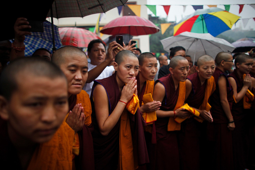 . Tibetan monks participate in celebrations to mark the birthday of their spiritual leader the Dalai Lama in Katmandu, Nepal, Saturday, July 6, 2013. The Tibetan leader turned 78 today. (AP Photo/Niranjan Shrestha)