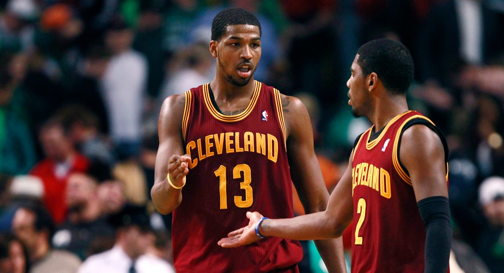 . Cleveland Cavaliers forward Tristan (13) shakes hands with teammate Kyrie Irving, right, after defeating the Boston Celtics 97-91 in an NBA basketball game in Boston, Friday, April 5, 2013. Thompson had 29 points in the win. (AP Photo/Charles Krupa)