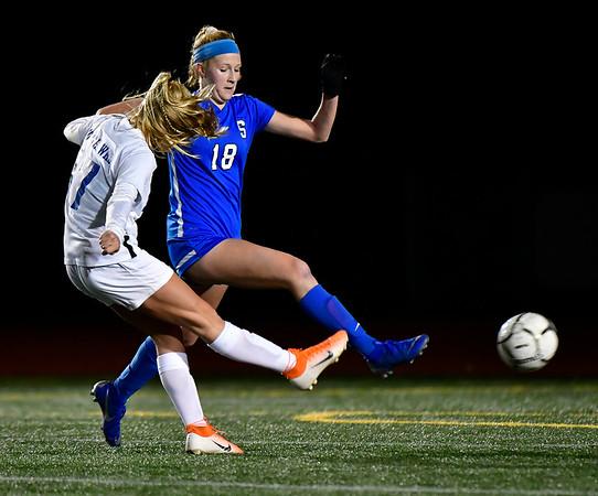 11/23/2019 Mike Orazzi | Staff Southington High School's Abigail Sowa (18) and Glastonbury's Samantha Forrest (17) during the Class LL Girls State Soccer Tournament at Veterans Stadium in New Britain Saturday evening. Glastonbury won 1-0.