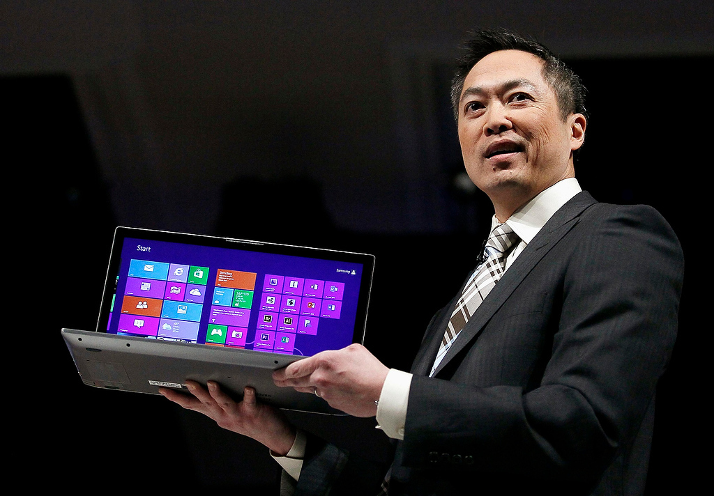 . Michael Abary, senior vice-president for Samsung Electronics America, shows off a Series 7 Chronos laptop at the Samsung news conference at the Consumer Electronics Show (CES) in Las Vegas January 7, 2013.  (REUTERS/Rick Wilking)