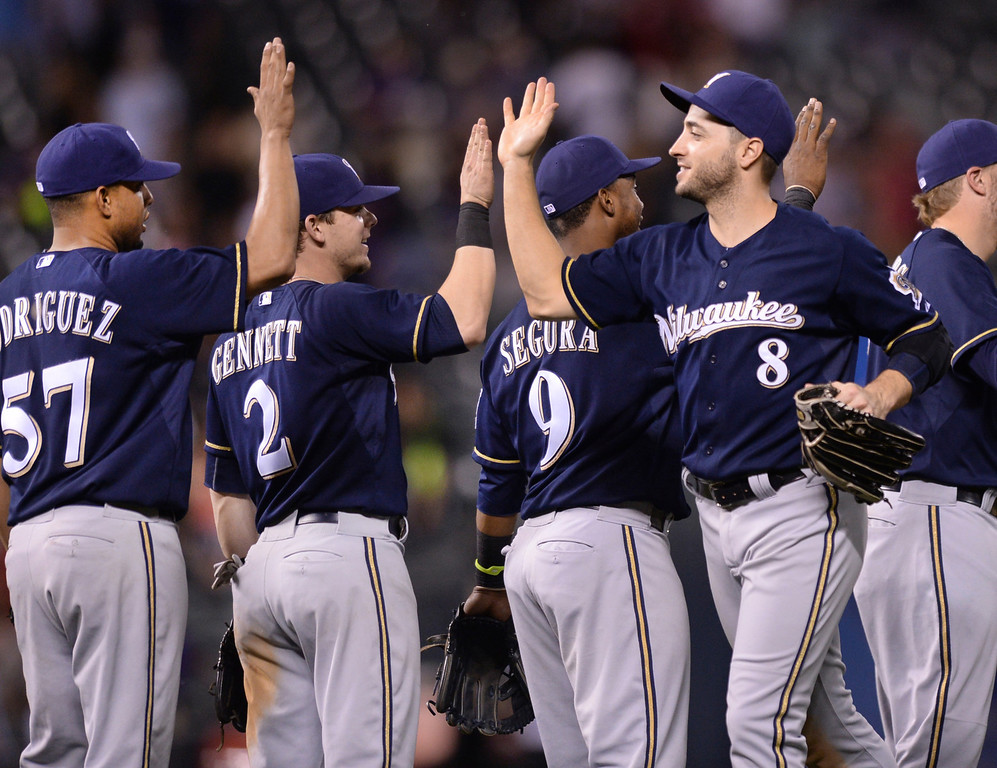 . DENVER, CO - JUNE 20: Ryan Braun celebrated the win with teammates Friday night. The Milwaukee Brewers defeated the Colorado Rockies 13-10 at Coors Field Friday night, June 20, 2014. Photo by Karl Gehring/The Denver Post